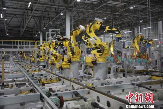 19日,北京现代重庆工厂在重庆两江新区举行落成仪式。图为工厂车间。 北京现代供图 摄