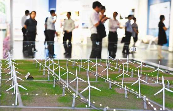七月九日,重庆市党政代表团来到东方电气集团中央研究院考察产业升级发展情况。四川日报记者 李向雨 摄