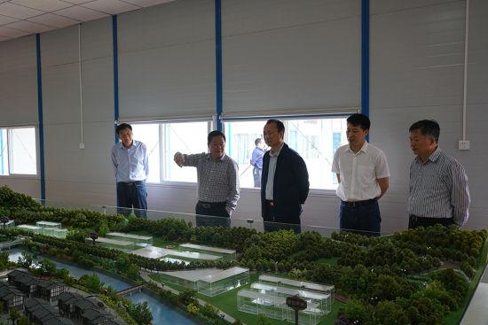 图为农工党重庆市委会考察三建乡场镇整体避险搬迁项目。农工党重庆市委会供图