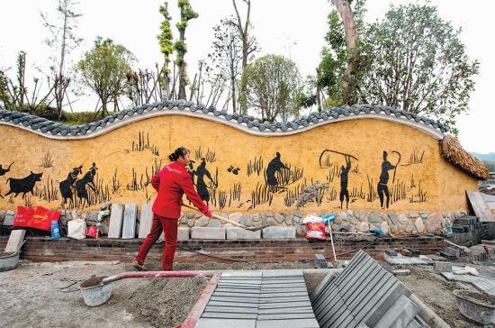 9月10日,楓香湖兒童公園,工人在進行古城墻施工.